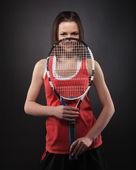 Portrait de joueur de tennis de fille sportive avec une raquette — Photo