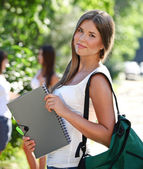 Happy young students outdoors — Stock Photo
