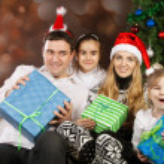 Happy family near the Christmas tree — Stock Photo