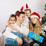 Happy family near the Christmas tree — Stock Photo #12935386