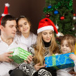Stock Photo: Happy family near the Christmas tree