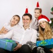 Happy family near the Christmas tree — Stock Photo