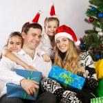 Happy family near the Christmas tree — Stock Photo #12935426