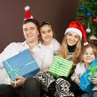 Happy family near the Christmas tree — Stock Photo #12935478