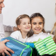 Happy family with presents — Stock Photo #12935485