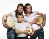 Happy smiling mother with children with drums — Stock Photo