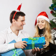 Happy couple near the christmas tree — Stock Photo #13186718