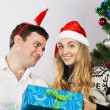 Happy couple near the Christmas tree — Stock Photo