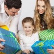 Happy family with presents — Stock Photo