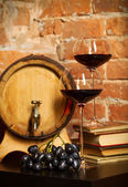 Retro still life with red wine and barrel — Stock Photo