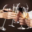 Holding glasses of white wine making a toast — Stock Photo
