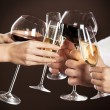 Holding glasses of white wine making a toast — Stock Photo #13193841
