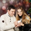 Portrait of a happy young couple near the Christmas tree — Stock Photo
