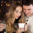 Stock Photo: Couple on blurred lights background