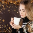 Beautiful blond young woman drinking coffee — Stock Photo