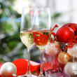 Glasses of champagne and Christmas decorations — Stock Photo