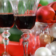 Stock Photo: Glasses of red wine and Christmas decorations