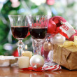 Glasses of red wine and Christmas decorations — Stockfoto