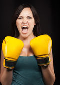 Portrait of a girl in yellow boxing gloves — Stock Photo