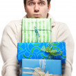 Royalty-Free Stock Photo: Surprised young man with presents