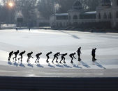 Silhouettes of ice skating — Stock Photo