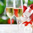 Glasses of champagne and Christmas decorations — Stock Photo #13369825