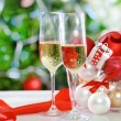 Glasses of champagne and Christmas decorations — Stock Photo #13369831