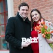 Happy young pregnant woman with her husband — Stock Photo #13497128