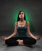 Young woman doing yoga — Foto de Stock
