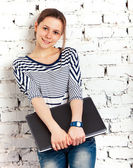 Teenager schoolgirl with laptop — Stock Photo