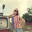 Blond girl on damaged gas station — 图库照片