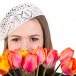 Stock Photo: Cute girl in parisian style with tulip flowers