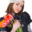 Stock Photo: Girl in parisian style with tulip flowers