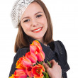Stock Photo: Cute brunette girl with tulip flowers