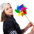 Young cute brunette girl with wind turbine toy — Stock Photo