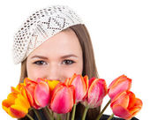 Cute girl in parisian style with tulip flowers — Stock Photo