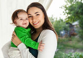 Happy smiling mother and her baby — Stock Photo