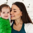 Happy smiling mother with lovely baby girl — Stock Photo