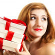 Beautiful young brunette girl with presents — Stock Photo #14803685