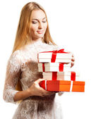 Happy young blond girl with presents — Stock Photo