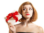 Beautiful young brunette girl holding present — Stock Photo