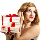 Beautiful young brunette girl with presents — Stock Photo