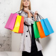 Young blond woman with shopping bags — Stock Photo