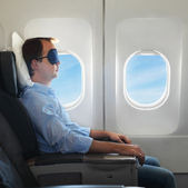Portrait of man relaxing in the airplane — Stock Photo