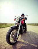 Biker on the country road — Foto Stock
