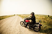 Biker on the country road — Stok fotoğraf