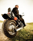 Biker on the country road — Stock Photo