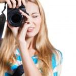 Creative woman photographer takes photos — Stock Photo