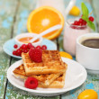 Delicious breakfast with fresh coffee, fresh waffles and fruits — Stock Photo #16970931
