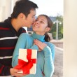 Stock Photo: Happy young couple in love with present